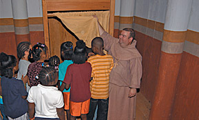 Church furnishings being explained by a costumed interpreter