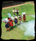 Demonstration of reenactors firing blackpoweder muskets at the Mision San Luis' fort, Castillo de San Luis.
